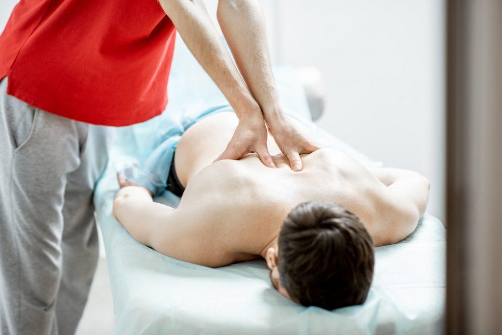 Masseur doing male massage